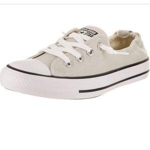 Converse slip-ons in cream. Never worn!